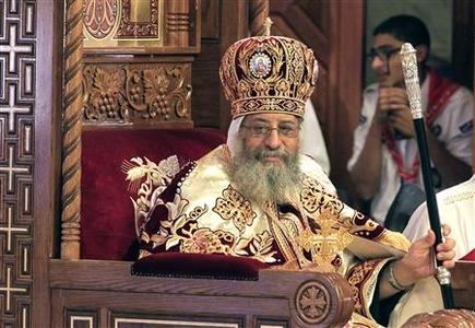 Pope Tawadros II, the new pope of the Coptic Orthodox church, attends his enthronement ceremony at St. Mark Cathedral in Abbasiya, Cairo November 18, 2012. The Coptic Orthodox church staged a ceremony rich in ritual on Sunday to install its pope, Tawadros II, who Christians hope will guide them through the new, Islamist-led Egypt. REUTERS/Mohamed Abd El Ghany