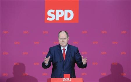 Peer Steinbrueck of the German Social Democratic party SPD addresses the media in Berlin October 30, 2012. The centre-left challenger to German Chancellor Angela Merkel in next year's elections and former finance minister Steinbrueck, fended off criticism of his lucrative earnings from speeches, books and company boards. REUTERS/Tobias Schwarz (GERMANY - Tags: POLITICS)