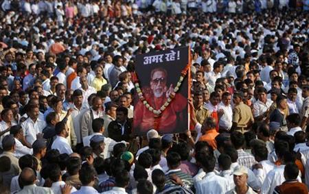 Supporters of the Shiv Sena party carry a portrait of right-wing Hindu nationalist politician Bal Thackeray before his funeral procession in Mumbai, November 18, 2012. REUTERS/Vivek Prakash