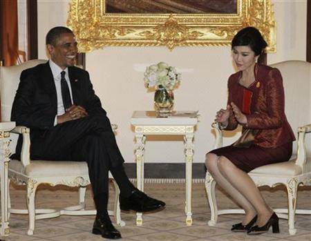 U.S. President Barack Obama listens to Thai Prime Minister Yingluck Shinawatra during their meeting at the Government House in Bangkok November 18, 2012. REUTERS/Sakchai Lalit/Pool
