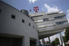 The logo of Deutsche Telekom AG is seen on top of the company's headquarter in Bonn May 24, 2012. Deutsche Telekom believes a complete sale of its T-Mobile USA unit is unlikely, the company told shareholders on Thursday, as it continues its search for a long-term solution for the troubled business. Picture taken with a tilt-shift lens. REUTERS/Wolfgang Rattay (GERMANY - Tags: BUSINESS TELECOMS LOGO)