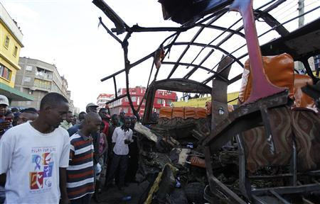 Residents look at the wreckage of a mini-bus (matatu) after it was hit by an explosion in the Eastleigh neighbourhood of Kenya's capital Nairobi, November 18, 2012. REUTERS/Thomas Mukoya