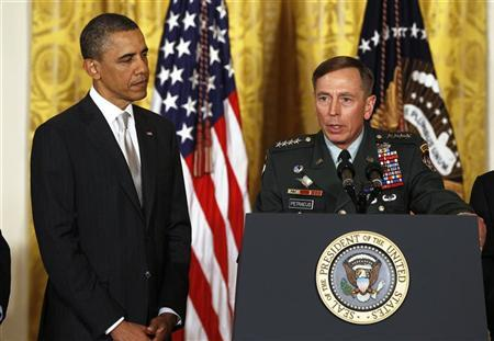 U.S. Army Gen. David Petraeus talks next to U.S. President Barack Obama at an event in the East Room of the White House in this April 28, 2011 file photo during Obama's announcement that then CIA Director Leon Panetta would be nominated as Secretary of Defense. REUTERS/Larry Downing