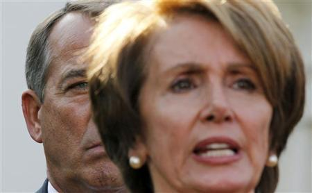 Speaker of the House John Boehner (L) listens to House Minority Leader Nancy Pelosi (R) after a bipartisan meeting with U.S. President Barack Obama in the Roosevelt Room of White House to discuss the economy, November 16, 2012. REUTERS/Larry Downing