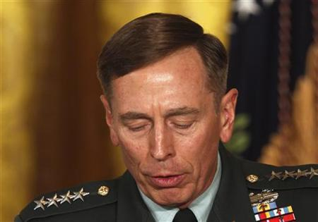 Then U.S. Army Gen. David Petraeus pauses at an event in the East Room of the White House in this April 28, 2011 file photo. REUTERS/Larry Downing/Files
