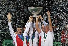 Czech Republic's team celebrates with the Davis Cup trophy after they defeated Spain in the final match in Prague November 18, 2012. REUTERS/Petr Josek