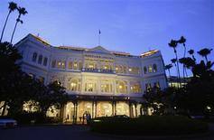 A general view of Raffles Hotel in Singapore is seen in this September 10, 2012 file photo. The best may be over for Singapore's booming hotel market as tightening corporate budgets and bank job cuts leave more luxury rooms empty, crimping profits at firms. Hong Kong's occupancy rate may pull ahead of Singapore's in 2013, largely because it has fewer new hotels slated to open. If Singapore's demand stays lukewarm next year, as many hotel operators expect, room rates and profits will slip. REUTERS/Tim Chong/Files