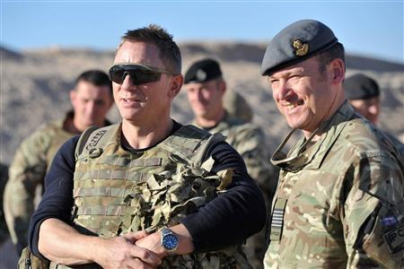 Actor Daniel Craig (L) speaks to military personnel during a visit to Camp Bastion in Helmand Province, Afghanistan November 18, 2012. Craig, who plays James Bond in the 007 secret agent films, met British soldiers and introduced the latest Bond film ''Skyfall'', which was being shown at the camp. REUTERS/Cpl Neil Bryden RAF/MoD/Crown Copyright/Handout
