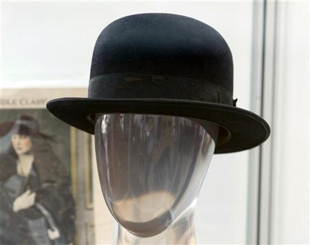 Charlie Chaplin's signature bowler hat from numerous productions such as ''The Tramp'' is pictured at a preview of actress Debbie Reynolds' Hollywood costume and prop collection in Beverly Hills June 6, 2011. REUTERS/Fred Prouser