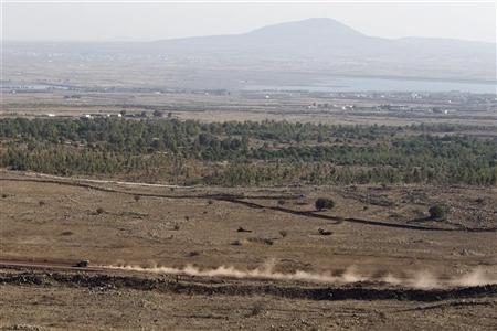 An Israeli military vehicle drives along the Israeli-Syrian border near Alonei Habashan in the Golan Heights November 4, 2012. REUTERS/Nir Elias