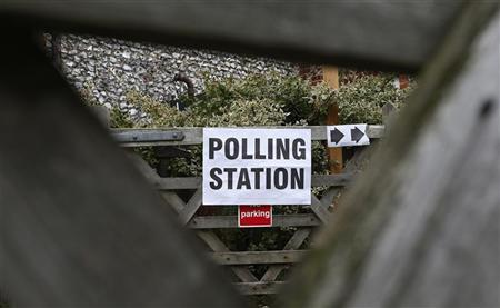 A sign for a polling station is seen through a gate in Hambleden, southern England November 15, 2012. Elections are taking place in England and Wales to choose 41 police and crime commissioners (PCCs). REUTERS/Suzanne Plunkett