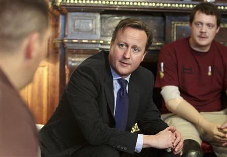 Britain's Prime Minister David Cameron meets injured soldiers and their families at Tedworth House, a Help for Heroes recovery centre, in Tidworth, southern England November 16, 2012. REUTERS/Steve Parsons/Pool
