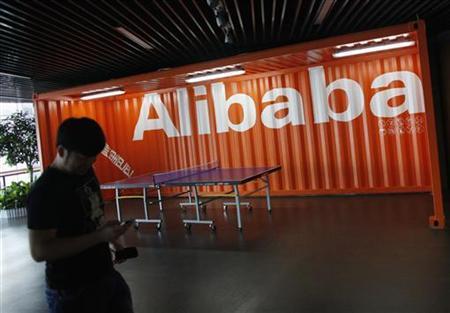 An employee walks past a logo of Alibaba (China) Technology Co. Ltd during a media tour organised by government officials at its headquarters on the outskirts of Hangzhou, Zhejiang province June 20, 2012. REUTERS/Carlos Barria