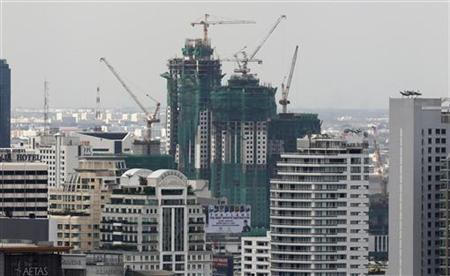 An office building under construction is seen in Bangkok's business district July 28, 2011. REUTERS/Sukree Sukplang