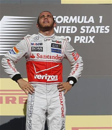McLaren Formula One driver Lewis Hamilton of Britain stands on the podium after winning the U.S. F1 Grand Prix at the Circuit of the Americas in Austin, Texas November 18, 2012. REUTERS/Adrees Latif