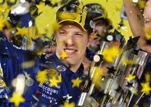 Brad Keselowski celebrates with the Sprint Cup which he clinched during the 2012 Ford EcoBoost 400 Sprint Cup NASCAR race, as confetti rains down on him at the Homestead-Miami Speedway in Homestead, Florida November 18, 2012. REUTERS/Gaston De Cardenas