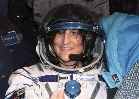 The International Space Station (ISS) crew member U.S. astronaut Sunita Williams smiles after landing near the town of Arkalyk, in northern Kazakhstan November 19, 2012. REUTERS/Maxim Shipenkov/Pool