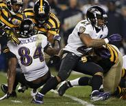 Baltimore Ravens' Ray Rice (R) runs the ball against the Pittsburgh Steelers in the third quarter of their NFL football game in Pittsburgh, Pennsylvania, November 18, 2012. REUTERS/Jason Cohn