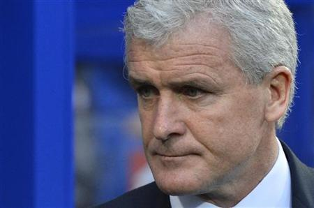 Queens Park Rangers' manager Mark Hughes reacts ahead of their English Premier League soccer match against Southampton at Loftus Road in London November 17, 2012. REUTERS/Toby Melville
