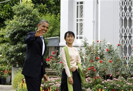 U.S. President Barack Obama and Myanmar's opposition leader Aung San Suu Kyi walk together during their meeting at her home in Yangon November 19, 2012. REUTERS/Soe Zeya Tun