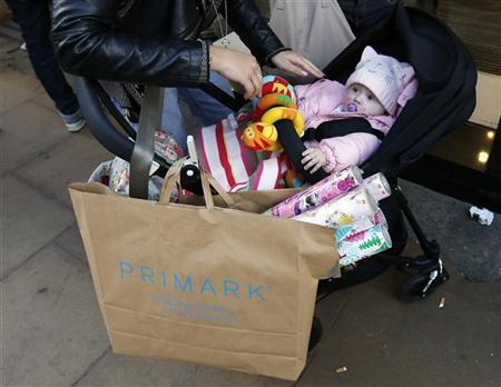 A shopping bag hangs from a pram outside a shop on Oxford Street in central London November 5, 2012. REUTERS/Olivia Harris
