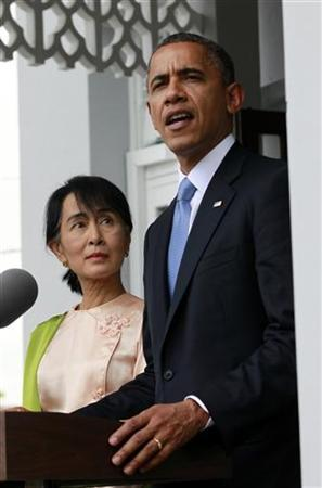 U.S. President Barack Obama speaks to the media alongside opposition leader Aung San Suu Kyi at her residence in Yangon November 19, 2012. Obama became the first serving U.S. president to visit Myanmar on Monday, trying during a whirlwind six-hour trip to strike a balance between praising the government's progress in shaking off military rule and pressing for more reform. REUTERS/Jason Reed (MYANMAR - Tags: POLITICS)