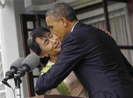 U.S. President Barack Obama kisses Myanmar's opposition leader Aung San Suu Kyi after their meeting at her residence in Yangon November 19, 2012. REUTERS/Soe Zeya Tun