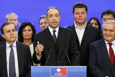 French politician Jean-Francois Cope (C) claims victory in a close election vote to head the UMP political party during a news conference at their headquarters in Paris November 18, 2012. France's UMP party members voted on Sunday to select its leader between current Secretary-General Cope and former Prime Minister Francois Fillon. Both Cope and Fillon have claimed victory as leader of the UMP political party. REUTERS/Benoit Tessier