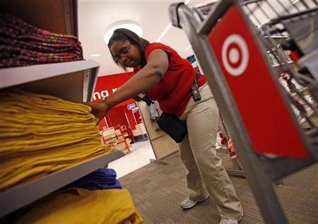 An employee at the new CityTarget store checks stock on the shelves during preparations for its opening in downtown Chicago July 18, 2012. REUTERS/Jim Young
