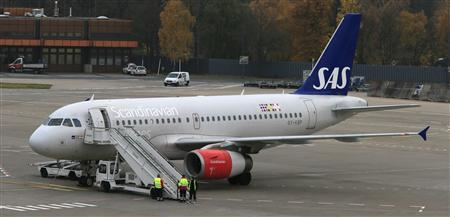 An aircraft operated by Scandinavian airline SAS is brought into position at the Berlin Tegel airport November 12, 2012. REUTERS/Tobias Schwarz