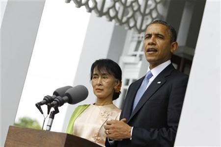 U.S. President Barack Obama talks to reporters during a news conference after meeting Myanmar's Opposition Leader Aung San Suu Kyi at her home in Yangon November 19, 2012. President Obama became the first serving U.S. president to visit Myanmar on Monday, trying during a whirlwind six-hour trip to strike a balance between praising the government's progress in shaking off military rule and pressing for more reform. REUTERS/Soe Zeya Tun (MYANMAR - Tags: POLITICS)