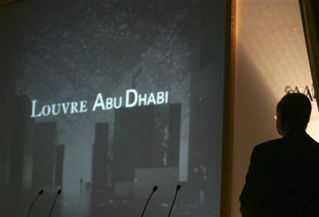 French Minister of Culture Renaud Vabres looks at a model of the Louvre Abu Dhabi on a big screen during the signing of a cultural exchange agreement in Abu Dhabi March 6, 2007. REUTERS/Osayd Hasan