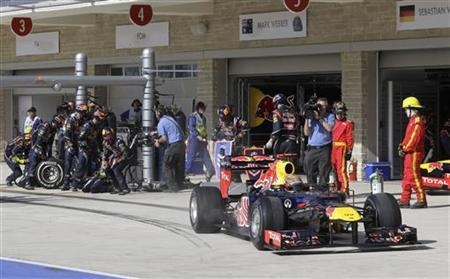 Red Bull Formula One driver Sebastian Vettel of Germany pulls out of the pit stall after a pit stop during the U.S. F1 Grand Prix at the Circuit of the Americas in Austin, Texas November 18, 2012. REUTERS/Luca Bruno/Pool