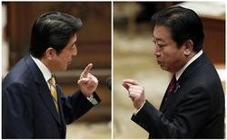 Japanese Prime Minister Yoshihiko Noda (R) and main opposition Liberal Democratic Party (LDP) leader Shinzo Abe speak at a parliamentary debate in Tokyo, in this November 14, 2012 file combination photo. REUTERS/Kim Kyung-Hoon/Files