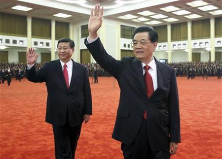 Chinese President Hu Jintao (R) and Xi Jinping, newly-elected general secretary of the Central Committee of the Communist Party of China (CPC) and chairman of the CPC Central Military Commission, wave to delegates of the 18th National Congress of the CPC at the Great Hall of the People in Beijing November 15, 2012. Picture taken November 15, 2012. REUTERS/China Daily (CHINA - Tags: POLITICS TPX IMAGES OF THE DAY) CHINA OUT. NO COMMERCIAL OR EDITORIAL SALES IN CHINA