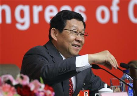 Chen Deming, China's Minister of Commerce, takes questions during an interview at the press center of the 18th National Congress of the Communist Party of China in Beijing, November 10, 2012. REUTERS/China Daily