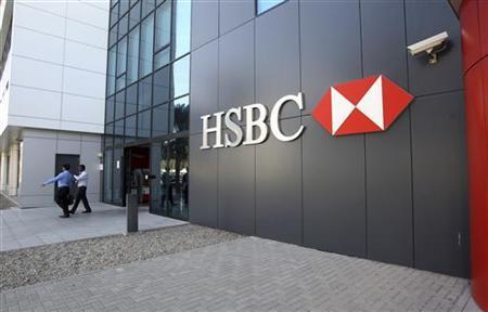 People exit an HSBC branch at Dubai Internet City in Dubai January 4, 2012. REUTERS/Nikhil Monteiro (UNITED ARAB EMIRATES - Tags: BUSINESS LOGO)