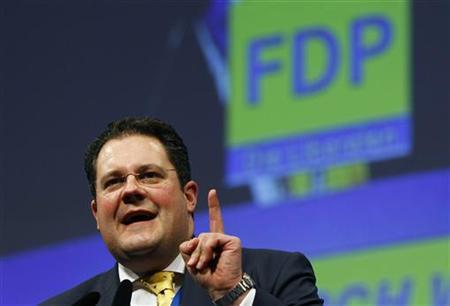 Secretary General Patrick Doering of the liberal Free Democratic Party (FDP) speaks during a two-day extraordinary party convention in Karlsruhe April 22, 2012. REUTERS/Ralph Orlowski (GERMANY - Tags: POLITICS)