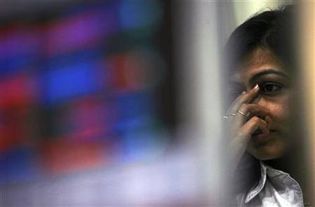A broker reacts while trading during the presentation of budget, at a stock brokerage in Mumbai February 26, 2010. REUTERS/Arko Datta/Files