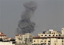 Smoke rises after an Israeli air strike in Gaza City November 19, 2012. Israel bombed dozens of suspected guerrilla sites in the Hamas-ruled Gaza Strip on Monday and Palestinian rocket fire from the enclave dropped off as international efforts to broker a truce intensified. REUTERS/Suhaib Salem