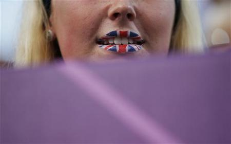 A woman's lips painted in the style of a Union Jack flag at Horse Guards Parade in London August 9, 2012. REUTERS/Marcelo Del Pozo/Files