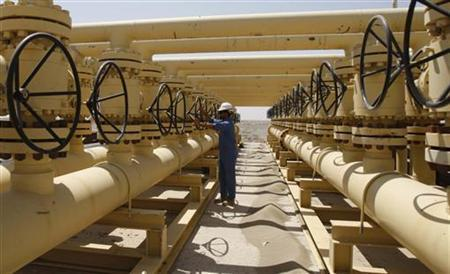 A worker adjusts a pipe at the Nassiriya oilfield in Nassiriya, 300km (185 miles) southeast of Baghdad,September 8, 2012. REUTERS/Atef Hassan
