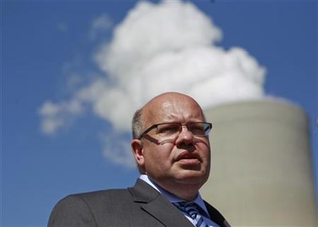 Germany's Environment Minister Peter Altmaier reacts in front of the new coal power plant during an official opening ceremony in the western city of Neurath August 15, 2012. Since the start of 2006, RWE Power has been building two new brown coal power plant units at Grevenbroich-Neurath. REUTERS/Ina Fassbender (GERMANY - Tags: POLITICS)