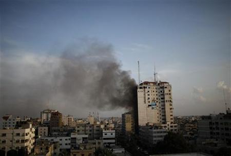 Smoke is seen after an Israeli air strike, witnessed by a Reuters journalist, on a building that also houses international media offices in Gaza City November 19, 2012. REUTERS/Ahmed Jadallah