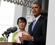U.S. President Barack Obama speaks to the media alongside Myanmar's opposition leader Aung San Suu Kyi at her residence in Yangon November 19, 2012. REUTERS/Jason Reed
