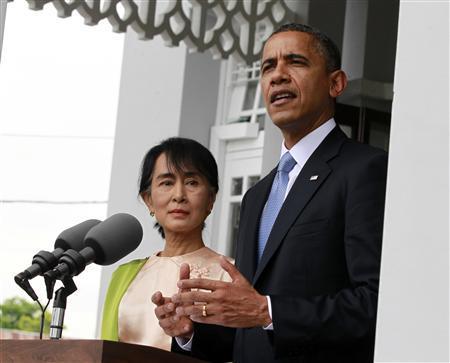 U.S. President Barack Obama speaks to the media alongside Myanmar's opposition leader Aung San Suu Kyi at her residence in Yangon November 19, 2012. REUTERS/Jason Reed