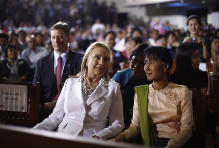 U.S. Secretary of State Hillary Clinton and Myanmar's Opposition Leader Aung San Suu Kyi (R) are pictured in the audience as President Barack Obama (not pictured) arrives to deliver remarks at the University of Yangon, November 19, 2012. REUTERS/Jason Reed