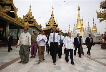 U.S. President Barack Obama (front 2nd R) and Secretary of State Hillary Clinton (front R) tour the Shwedagon Pagoda in Yangon November 19, 2012. Obama became the first serving U.S. president to visit Myanmar on Monday, trying during a whirlwind six-hour trip to strike a balance between praising the government's progress in shaking off military rule and pressing for more reform. REUTERS/Jason Reed