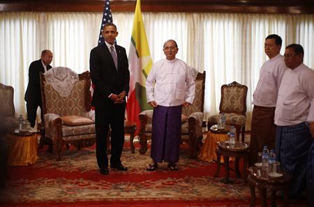 U.S. President Barack Obama (2nd L) stands next to Myanmar's President Thein Sein (C) during their meeting in Yangon November 19, 2012. Obama became the first serving U.S. president to visit Myanmar on Monday, trying during a whirlwind six-hour trip to strike a balance between praising the government's progress in shaking off military rule and pressing for more reform. REUTERS/Jason Reed