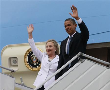 U.S. President Barack Obama and U.S. Secretary of State Hillary Clinton wave upon arriving at Yangon International Airport November 19, 2012. Obama has become the first serving U.S. president to visit Myanmar, arriving on Monday for a trip that will attempt to strike a balance between praising the government's progress in shaking off military rule and pressing it for further reforms. REUTERS/Jason Reed
